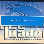Open disc cover, take Freeloader out, put game disc in.